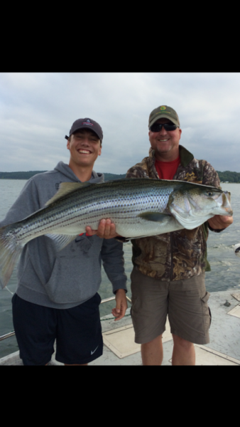 [Image: Check out this catch! This large fish is called a striper. ]